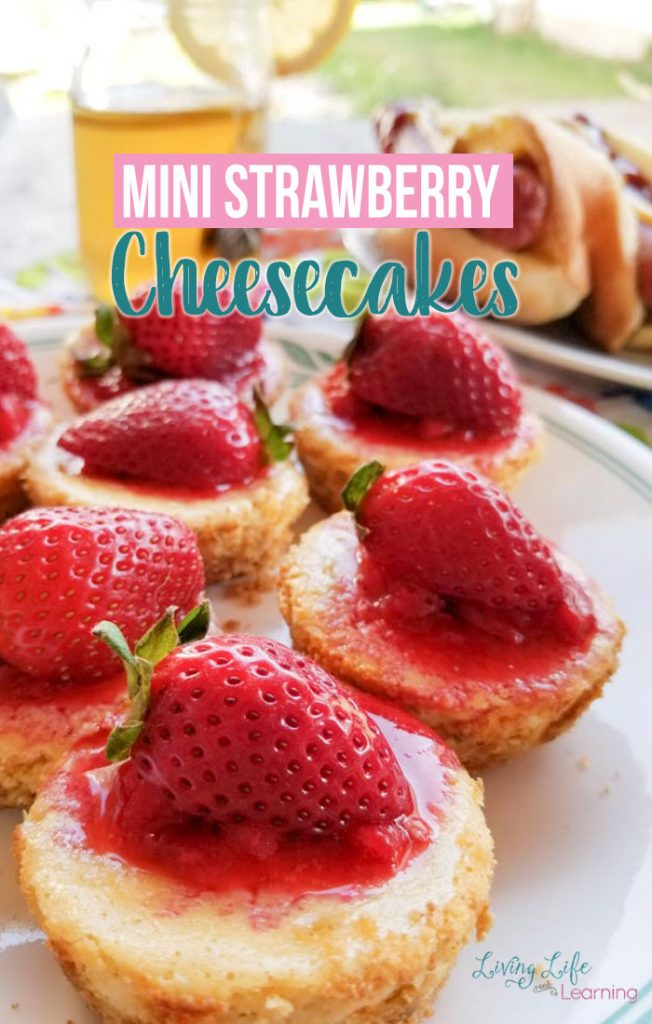 Mini Strawberry Cheesecake Recipe - A family favorite dessert the whole family will enjoy and it's worth the time you put into it. Add fresh strawberries to your favorite cheesecake to make it a refreshing summer dessert everyone will a love.