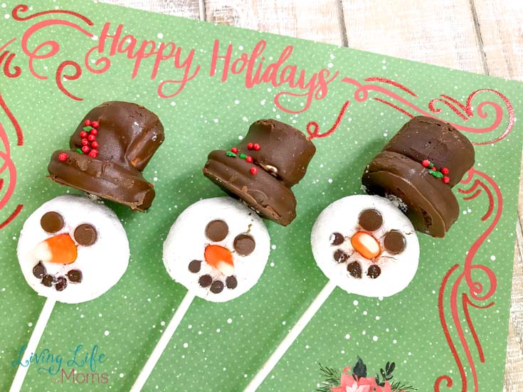 These Snowman Donut Pops are a simple and fun holiday treat that the entire family will love! No baking required, you'll fall in love with the taste and look of these edible snowmen!  #snowman #donuts #holidaytreats #winter #LivingLifeasMoms