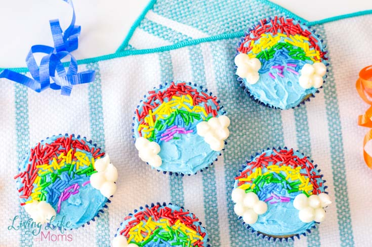 These Rainbow Sprinkles Cupcakes are too cute and easy to make! Perfect for birthday parties or just as a fun dessert, everyone will love these decorated cupcakes! #dessert #cupcakes #decoratingcupcakes #rainbows