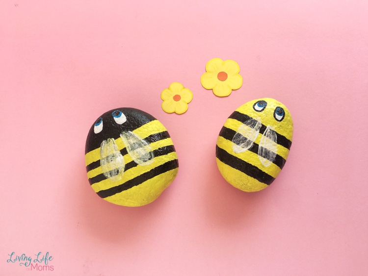 Cute buzzing bee painted rocks in yellow and black