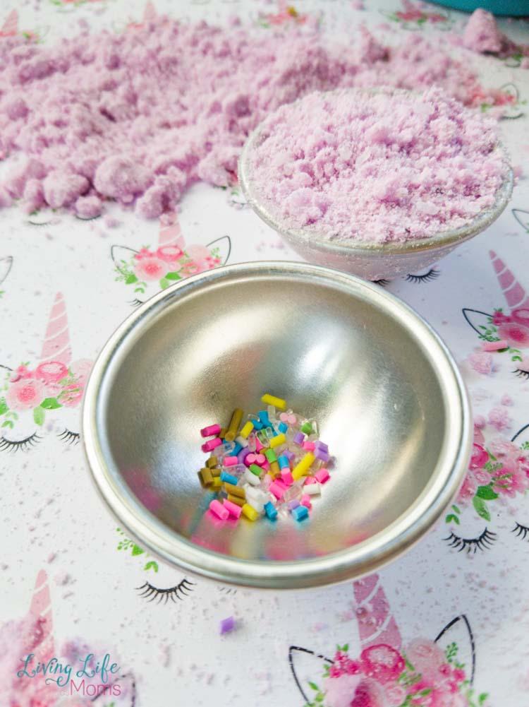 Add sprinkles for unicorn bath bomb in mold