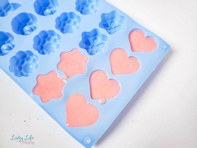 Poured soap mixture into soap moulds.